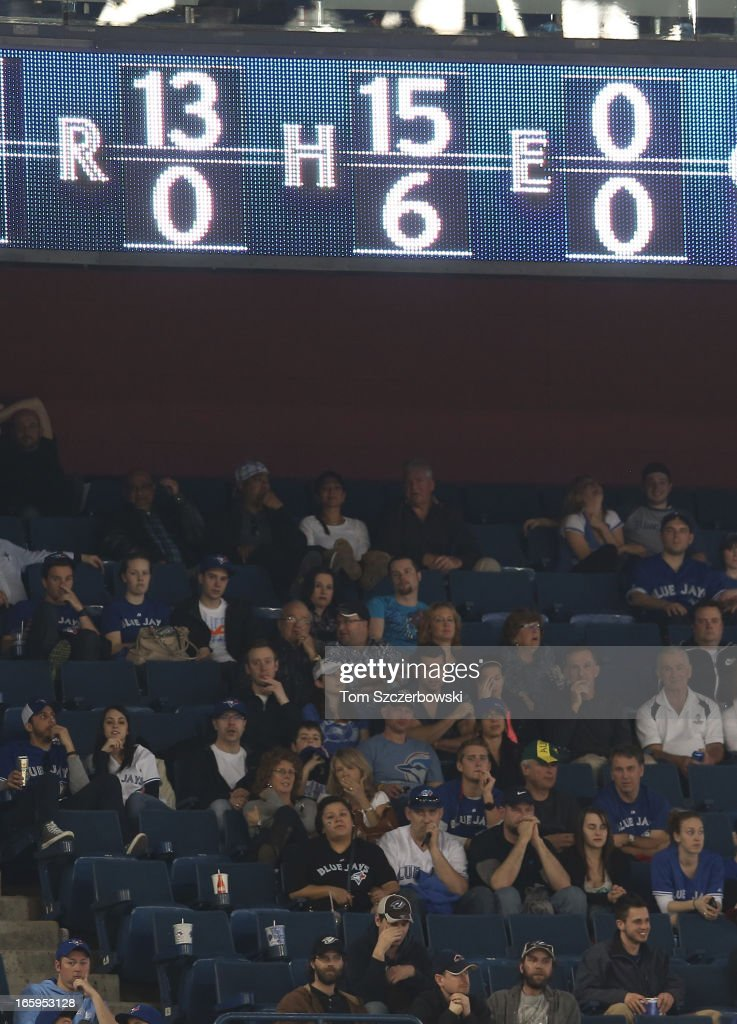 The scoreboard shows the score in the ninth inning of the Boston Red Sox victory over the Toronto Blue Jays during MLB game action on April 7, 2013 at Rogers Centre in Toronto, Ontario, Canada.