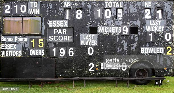 The scoreboard shows yesterday's score as rain delays the start of play during day one of the LV County Championship match between Essex and...