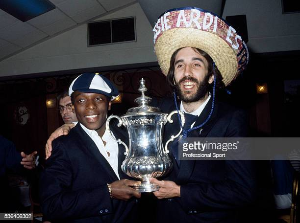 The scorer of the winning goal for Tottenham Hotspur Ricardo Villa celebrates with Garth Crooks and the FA Cup at the party after their victory in...