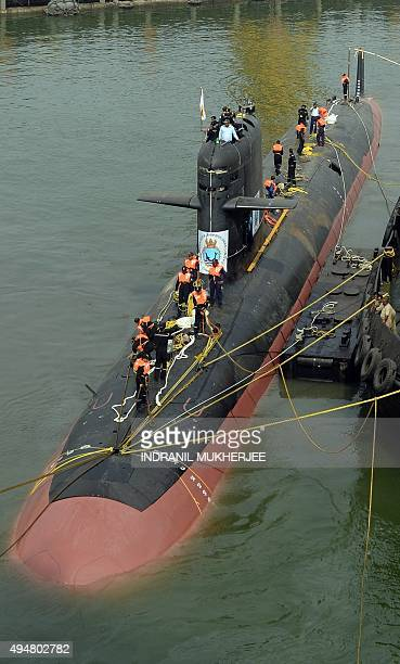 The Scorpene submarine 'Kalvari' is escorted by tugboats as it cruises into the Naval Dockyard in Mumbai on October 29 2015 'Kalvari' the first...
