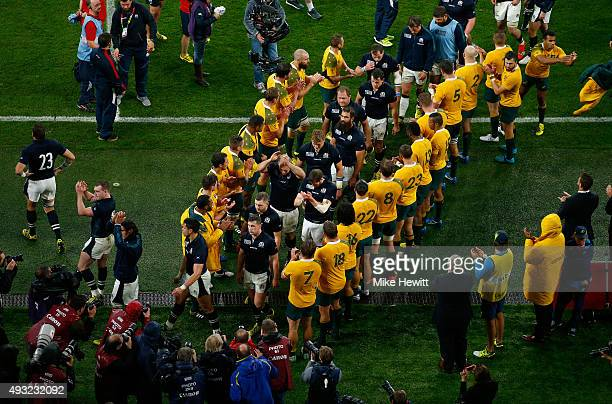 The Scotland team are applauded off by the Australian team after the 2015 Rugby World Cup Quarter Final match between Australia and Scotland at...