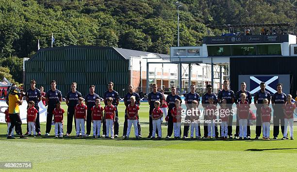 The Scotland team stand for their National Anthem during the ICC Cricket World Cup match between New Zealand and Scotland at University Oval on...