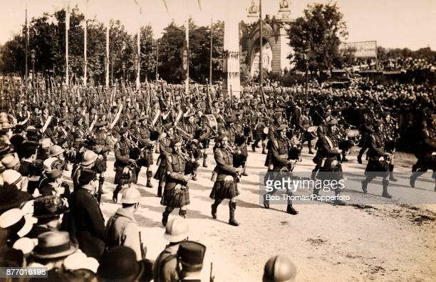 The Scots' Guard led by Scottish bagpipers march in the Victory Parade in Paris following World War One on Bastille Day the 14th July 1919