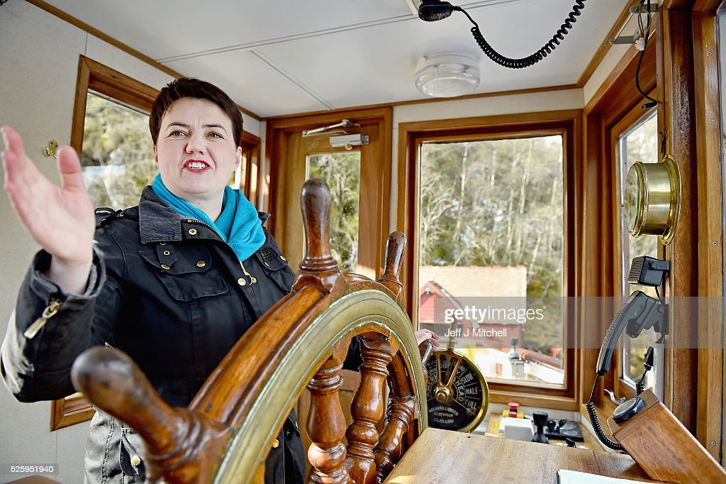 The Scottish Conservative leader <a gi-track='captionPersonalityLinkClicked' href=/galleries/search?phrase=Ruth+Davidson&family=editorial&specificpeople=8602778 ng-click='$event.stopPropagation()'>Ruth Davidson</a> stands in the wheelhouse as she meets the crew and staff on the tourist attraction the Sir Walter Scott Steamship on April 29, 2016 in Loch Katrine. Recent polls this week have shown that the Scottish Conservatives could overtake Labour as the opposition party in next month's Holyrood election.