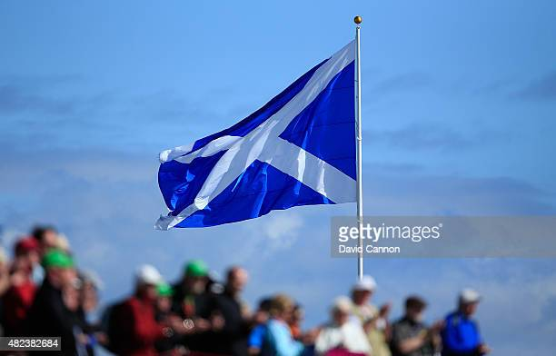 The Scottish flag flies as fans look on during the First Round of the Ricoh Women's British Open at Turnberry Golf Club on July 30 2015 in Turnberry...