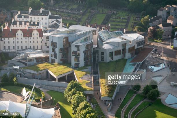 The Scottish Parliament is pitctures at sunset from Salisbury Crags in Holyrood Park Edinburgh Scotland on June 25 following the proBrexit result of...
