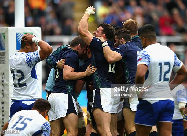 The Scottish players celebrate after the third try during the 2015 Rugby World Cup Pool B match between Samoa and Scotland at St James' Park on...