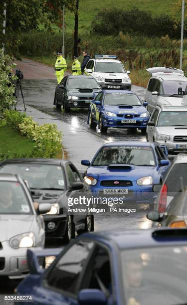 The Scottish Subaru Imprezza owners club leave the entrance to Colin Mcrae's house after laying flowers He died in a helicopter crash in the grounds...
