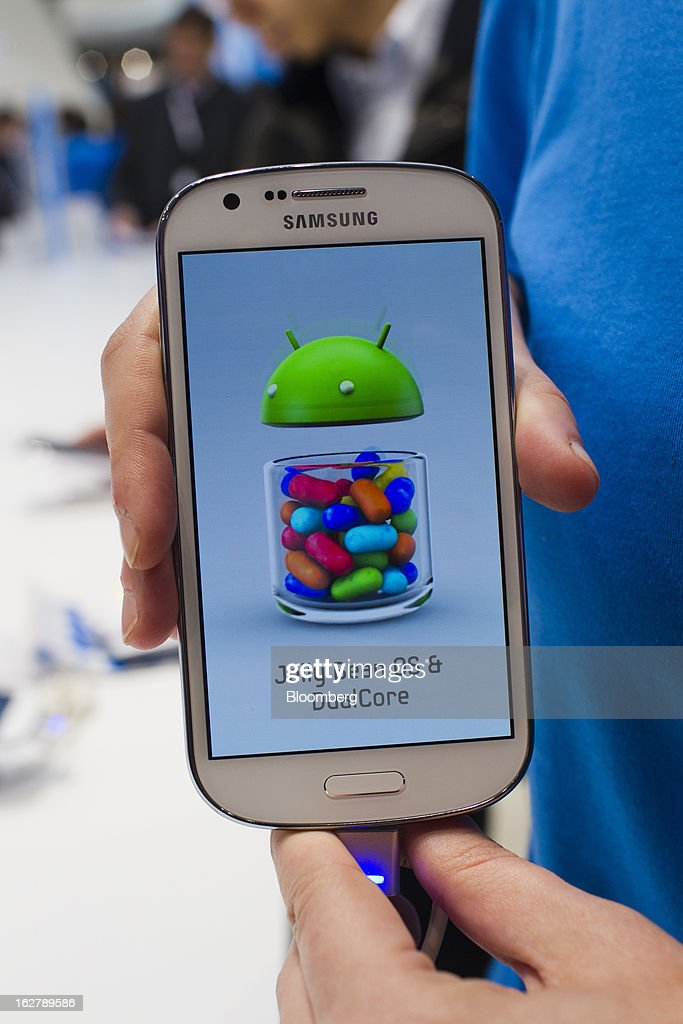 The screen of a Samsung Electronics Co. Galaxy Express smartphone displays the Android Jelly Bean OS and DualCore logos at the Mobile World Congress in Barcelona, Spain, on Wednesday, Feb. 27, 2013. The Mobile World Congress, where 1,500 exhibitors converge to discuss the future of wireless communication, is a global showcase for the mobile technology industry and runs from Feb. 25 through Feb. 28. Photographer: Angel Navarrete/Bloomberg via Getty Images