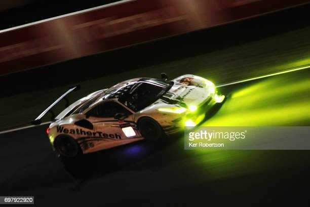 The Scuderia Corsa Ferrari 488 of Townsend Bell Bill Sweedler and Copper MacNeil drives during the Le Mans 24 Hours race at the Circuit de la Sarthe...