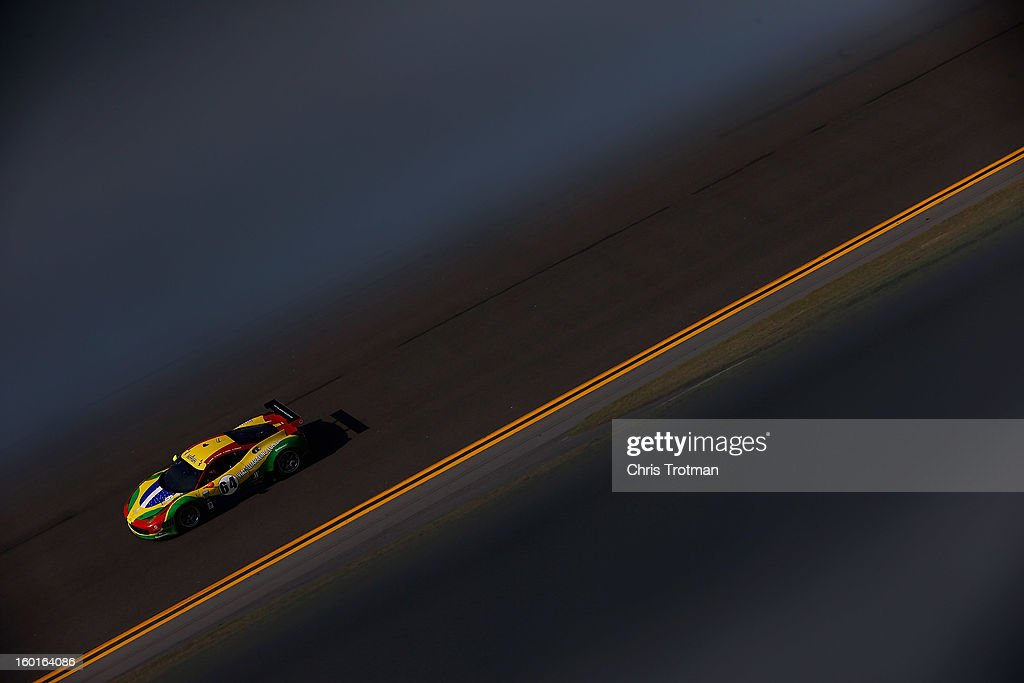 The #64 Scuderia Corsa Michelotta Ferrari 458 driven by Chico Longo, Xandinhon Negrao, Daniel Serra and Raphael Matos drives during the Rolex 24 at Daytona International Speedway on January 27, 2013 in Daytona Beach, Florida.
