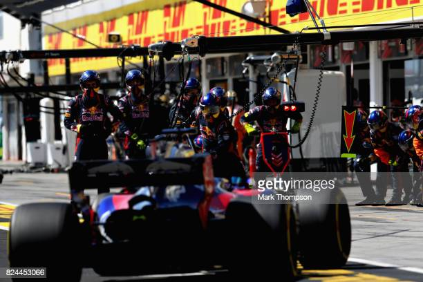 The Scuderia Toro Rosso team prepare as Daniil Kvyat of Russia driving the Scuderia Toro Rosso STR12 comes in for a pit stop during the Formula One...