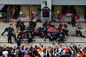 The Scuderia Toro Rosso team take part in a pit stop practice session ahead of the Austrian Formula One Grand Prix at Red Bull Ring on June 19 2014...