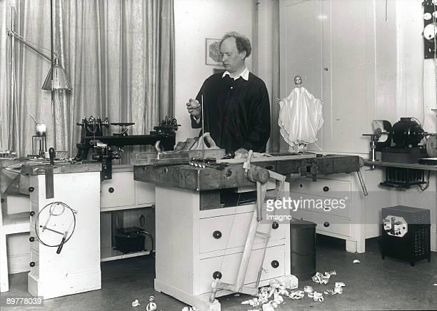 The sculptor and puppet player Richard Teschner in his atelier Messerschmidgasse Waehring Vienna Lantern slide 1924
