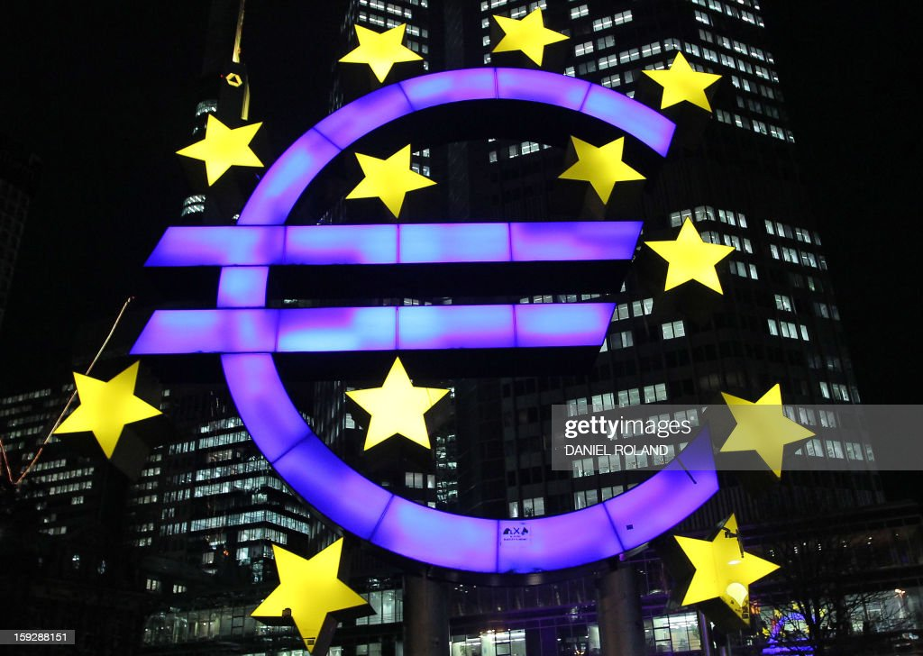 The illuminated EURO sign is seen in front of the European Central Bank, ECB in Frankfurt am Main, western Germany, on January 10, 2013. The euro shot up, gaining 1.5 percent against the dollar, after European Central Bank chief Mario Draghi made upbeat remarks about the eurozone's economic outlook. AFP PHOTO / DANIEL ROLAND