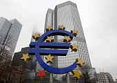 The euro sign sculpture is pictured in front of the building that used to host the headquarters of the European Central Bank in Frankfurt am Main...