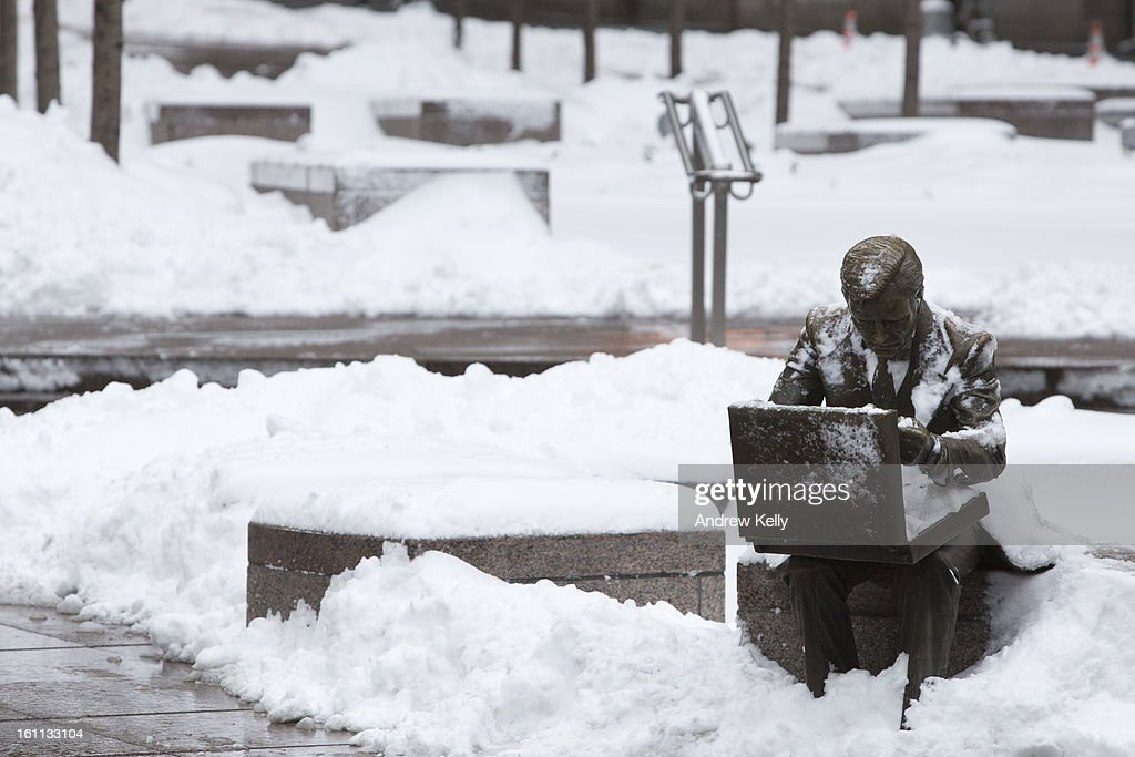 The sculpture 'Double Check' by John Seward Johnson II is seen in Zuccotti Park following a major winter storm on February 9, 2013 in New York City. New York City and much of the Northeast received a foot or more of snow through Saturday morning with possible record-setting blizzard conditions expected. Heavy snow warnings are in effect from New Jersey through southern Maine.