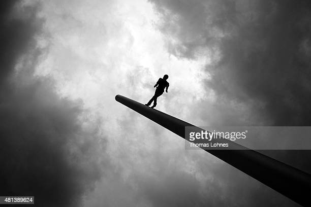 The sculpture 'Man walking to the sky' of the artist Jonathan Borofskyon as a part of the 'documenta IX' pictured on July 19 2015 in Kassel Germany...