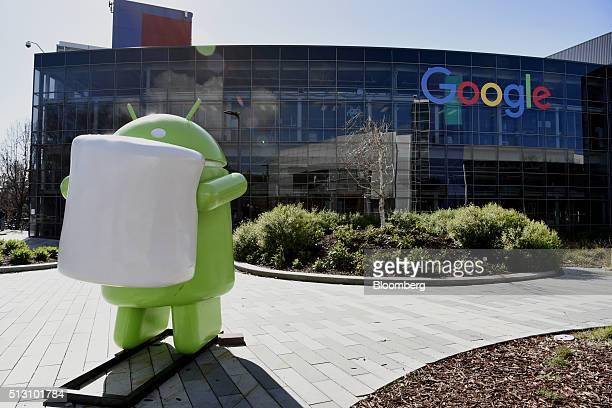 The sculpture of a Google Inc's Android mobile operating system mascot sits inside the Googleplex headquarters in Mountain View California US on...