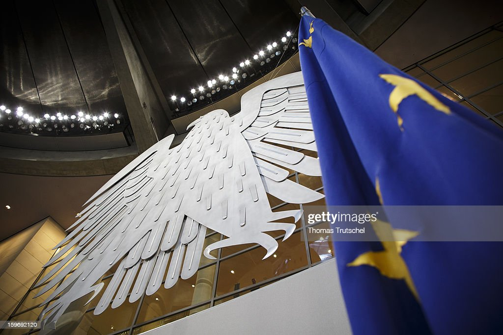The sculpture of an eagle and the european flag seen at Reichstag, the seat of the German Parliament (Bundestag) on January 18, 2013 in Berlin.
