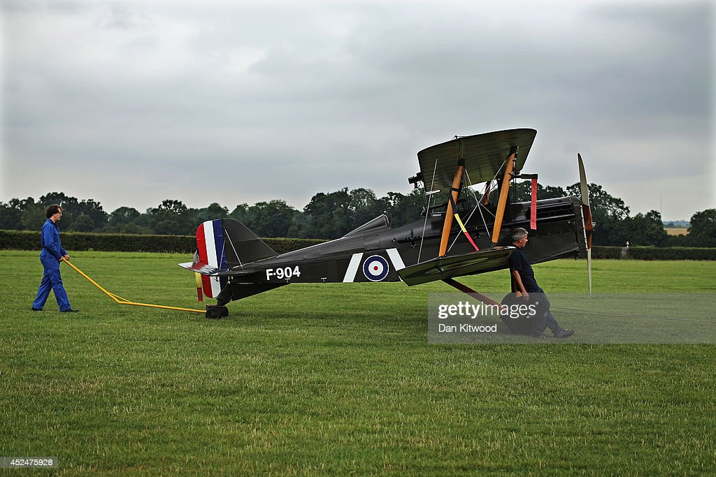 The SE5a is taken to position for demonstration flight at 'The Shuttlesworth Collection' at Old Warden on July 21, 2014 in Biggleswade, England. Of the 55,000 planes that were manufactured by the Royal Army Corps (RAC) during WWI, only around 20 remain in airworthy condition. Six of these belong to The Shuttleworth Collection at Old Warden, Bedfordshire, making it the most complete collection of original airworthy WWI aircraft in the world. Amongst the collection is the SE5a. The SE5a is a single seater fighter aircraft. It is an original biplane designed by the Royal Aircraft Factory, with its engine built by Wolseley Motors Ltd, and it was issued to 84 Squadron in November 1918. The National Archive in Kew has recently verified that the plane saw action in France with 84 Squadron the day before Armistice, November 10, 1918.