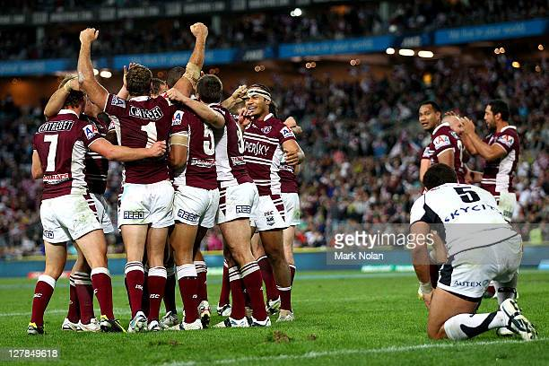The Sea Eagles celebrate the try of Jamie Lyon at fulltime during the 2011 NRL Grand Final match between the Manly Warringah Sea Eagles and the...