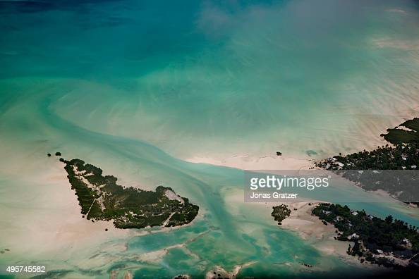 The sea increases day by day and is slowly consuming Kirabati islands The people of Kiribati are under pressure to relocate due to sea level rise...