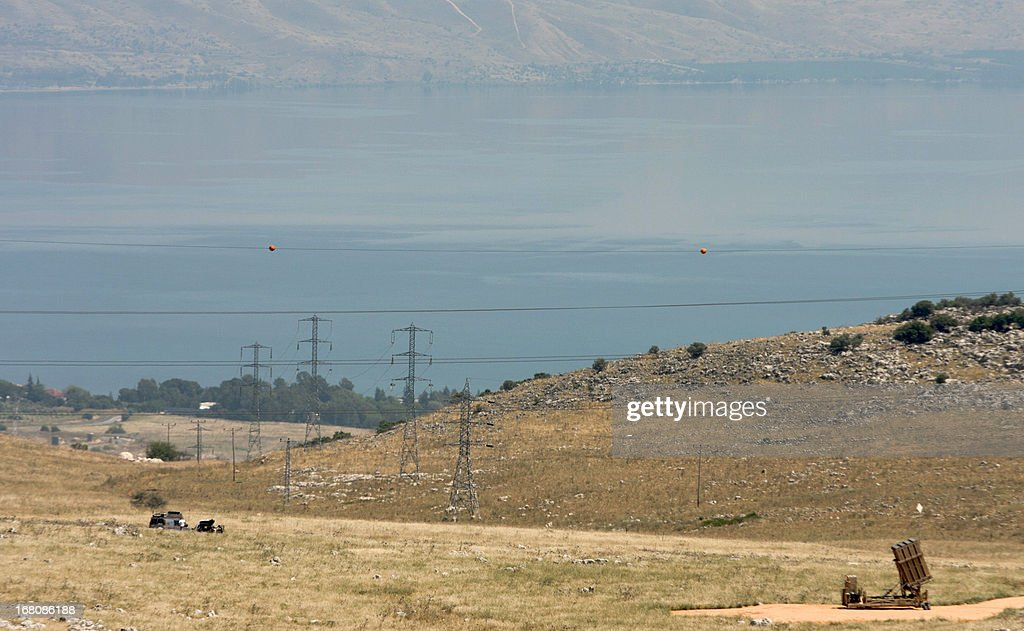 The Sea of Galilee is seen in the background as an Iron Dome, a short-range missile defence system, is positioned on a hill in northern Israel, on May 5, 2013. Israeli strikes hit a military target outside Damascus the Jewish state's second reported raid on Syria in three days, with residents saying the attack felt like an earthquake and turned the sky red.