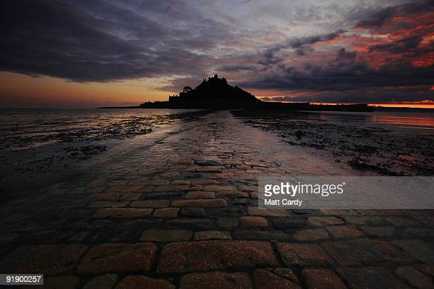 The sea retreats from the causeway leading to St Michael's Mount on October 14 2009 in Penzance England The tidal island which has houses shops a...