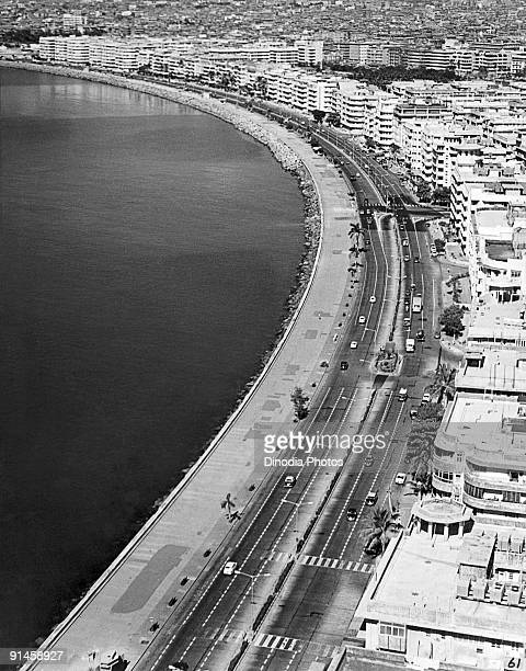 The seafront at Marine Drive in Bombay India 1940s It is known as The Queens Necklace because it resembles a string of gems when viewed from above at...