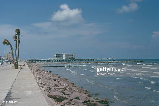 The seafront in Galveston Texas USA with the USS Flagship Hotel in the background centre on the pier circa 1960
