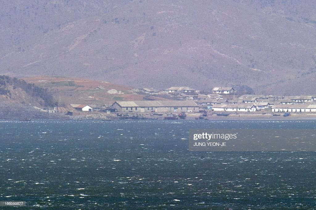 The seafront of North Korea's west coast is seen from the South Koreacontrolled island of Yeonpyeong near the disputed waters of the Yellow Sea on...