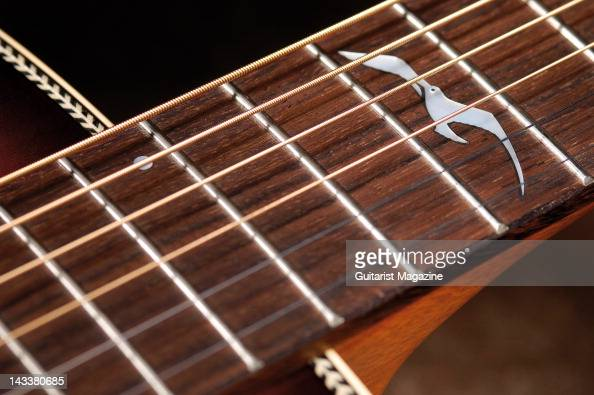 The Seagull shaped 12th fret inlay of a Seagull Artist Studio Burst acoustic guitar during a studio shoot for Guitarist Magazine October 17 2007