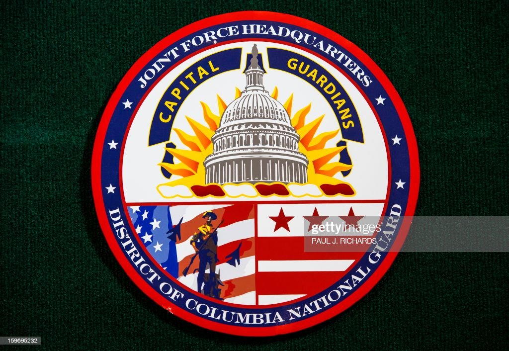 The logo for the Joint Force Headquarters Capital Guardians District of Columbia National Guard is seen during a press conference. The first group of US National Guard Soldiers and Airmen from more than 25 US States, have arrivied to take a legal oath to officially make them deputized 'special police officers' for the 57th Presidential Inauguration in the District of Columbia, during 'in-processing' at the DC National Guard Armory January 18, 2013, in Washington. The National Guard will provide a myriad of support to civil authorities. Photo/Paul J. Richards