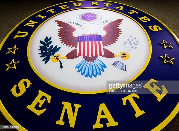 The seal for the US Senate is seen hanging on the wall inside the Senate RadioTV gallery on December 27 on Capitol Hill in Washington DC AFP...