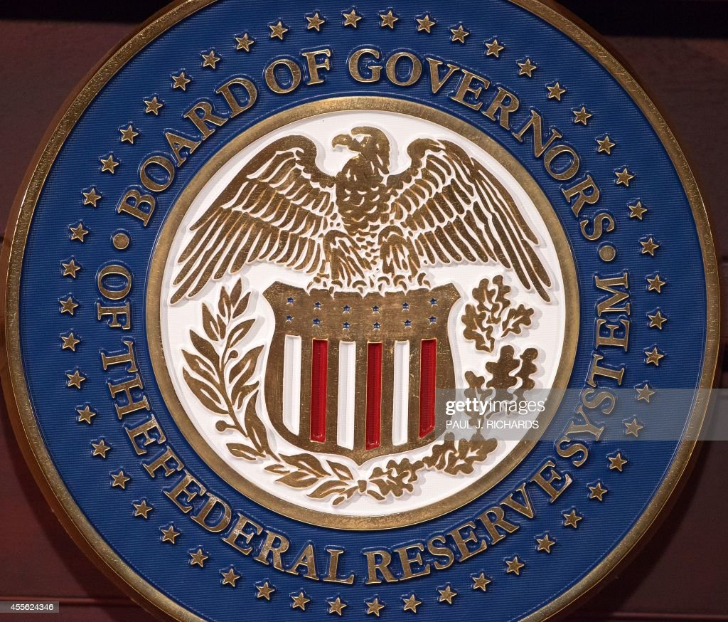 The seal of the Board of Governors of the Federal Reserve System is seen on the lectern during a press conference September 17 2014 at the US Federal...