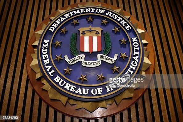 The seal of the FBI hangs in the Flag Room at the bureau's headquaters March 9 2007 in Washington DC FBI Director Robert Mueller was responding to a...