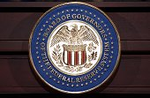 The seal of the Federal Reserve Board of Governors is seen during a press conference by Federal Reserve Chairman Ben Bernanke on June 19 2013 at the...