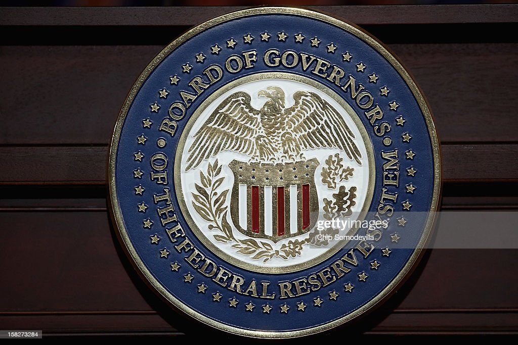 The seal of the Federal Reserve is on display as Chairman Ben Bernanke holds a press conference following a Federal Open Market Committee meeting at...