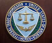 The logo of the Federal Trade Commission is seen on the lecturn in the Commissioner's Conference Room January 15 2014 inside the FTC headquarters in...