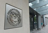 The seal of the International Monetary Fund is seen on a headquarters building in Washington DC on July 5 2015 The euro was dropping against the...