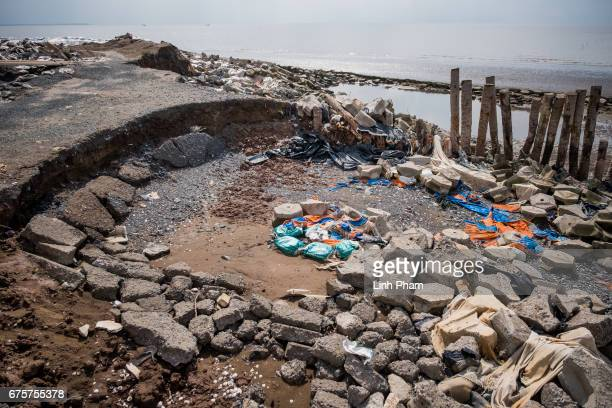 The seaside road was destroyed by high tides on April 29 2017 in Bao Thuan Village Ba Tri District Ben Tre Province Vietnam The Mekong River Delta is...