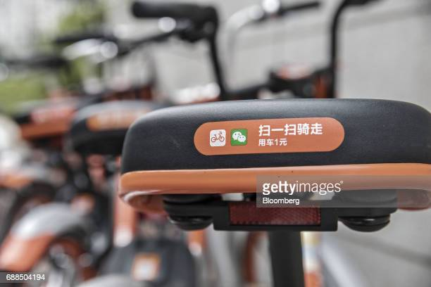 The seat of a Mobike bicycle is seen on a sidewalk in Shanghai China on Thursday May 25 2017 In China a bicyclesharing phenomenon is changing the way...
