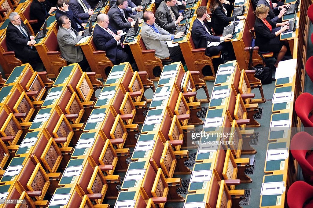 The seats of the Hungarian Socialist deputies remain empty with a exclamation mark on the table during the parliamentary session to vote on changes to the constitution on March 11, 2013 in Budapest, as the fourth modification vote of the basic law took place with 265 votes in favour, 11 against and 33 member abstaining. The opposition Socialists party boycotted the vote. The changes, which have also sparked protests in Budapest, include a curb on the power of the constitutional court and reintroduce controversial measures rendered void by the court in recent months.