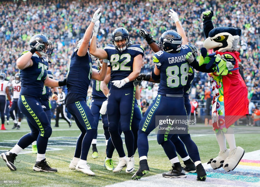 The Seattle Seahawks, including Luke Willson #82 and mascot Blitz celebrate a 1 yard touchdown by tight end Jimmy Graham #88 during the fourth quarter of the game at CenturyLink Field on October 29, 2017 in Seattle, Washington.