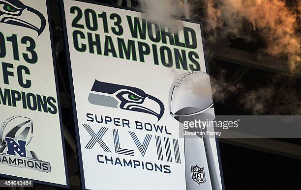 The Seattle Seahawks Super Bowl Championship banner is unfurled before the game between the Green Bay Packers and the Seattle Seahawks at CenturyLink...