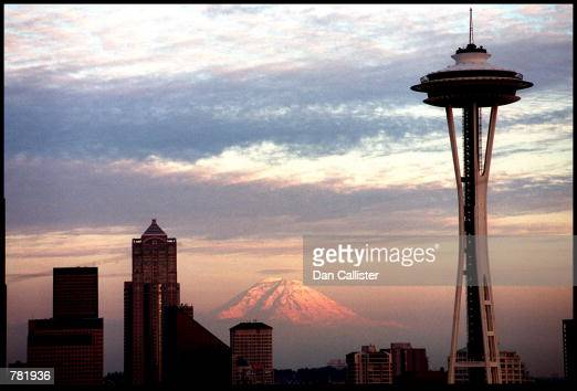 The Seattle Space Needle is viewed during dusk with Mt Rainier in the background May 30 2000 in Seattle WA