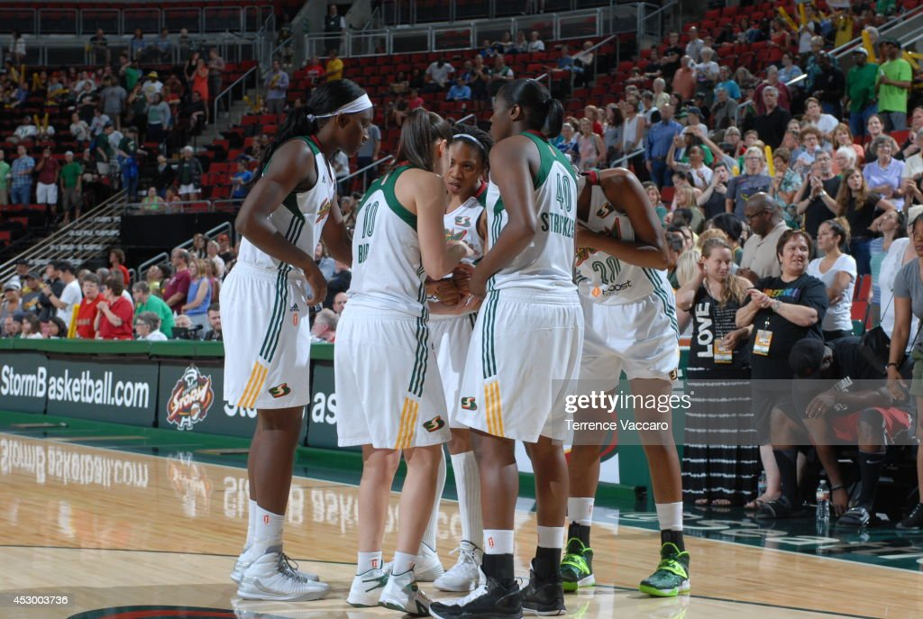 The Seattle Storm huddle during the game against the Indiana Fever on July 31,2014 at Key Arena in Seattle, Washington.