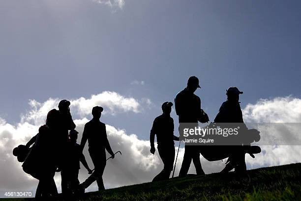 The second group of Rickie Fowler of the United States and Jimmy Walker of the United States and Thomas Bjorn of Europe and Martin Kaymer of Europe...