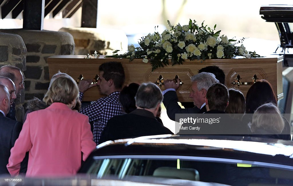 The second of the two coffins carrying the body of Ross Simons and his wife Clare is carried into Westerleigh Crematorium for their joint funeral on February 15, 2013 in Bristol, England. The couple were killed when their tandem bike collided with a car in Hanham. A 38-year-old man has been charged with two counts of causing death by dangerous driving after Ross Simons, 34, and Clare, 30, died at the scene of the crash in Bristol on January 27, 2013.
